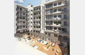 Residential from developers for sale in Catalonia. Two-level apartment with a terrace in a new building, Poblenou, Barcelona, Spain