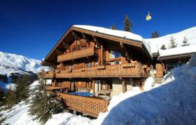 Villas and houses for rent with swimming pools in French Alps. Stunning chalet with private pool on the terrace in the fashionable ski resort in Meribel, France