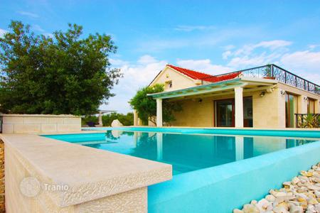 Houses with pools for sale in Split-Dalmatia County. Premium class villa with swimming pool, relaxation area and views of the sea in the village of Sutivan, island of Brac