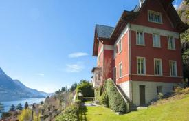 Luxury houses for sale in Laglio. Renovated ancient villa with a view of Lake Como, a fireplace and a big garden