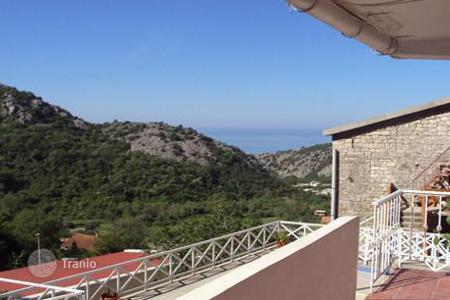 Coastal residential for sale in Chanj. Two-storey house with a rooftop terrace, orange garden and scenic views of the sea, Chan, Montenegro