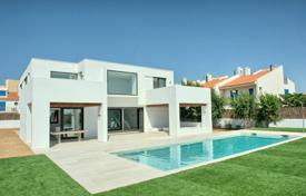 Luxury houses with pools for sale in Costa Brava. Modern villa with a greenhouse and a swimming pool, on the first line of the sea, Bas Empordà, Girona