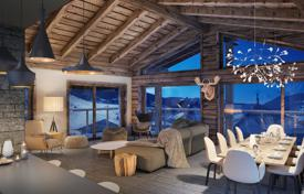 Luxury new homes for sale in French Alps. Apartment with a balcony and a sauna with mountain views, in a new residence, in the center of the ski resort, Les Gets, Alpes, France