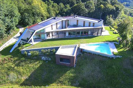 Houses with pools for sale in Friuli-Venezia Giulia. Modern villa with wine cellar, vinery and breathtaking view over plain and Alpine foothill in Udine region, Italy