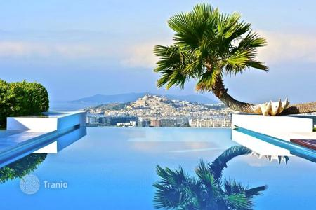 Luxury houses with pools for sale in Ibiza. Modern villa with amazing views of the sea and the mountains