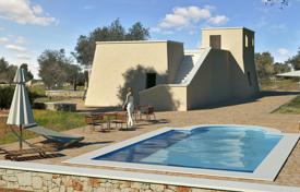 Off-plan houses with pools for sale in Southern Europe. Land with approved project of villa, Salve, Italy