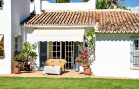 Luxury houses for sale in Estepona. Cozy villa with a private garden, a pool, a garage and a terrace, Estepona, Spain