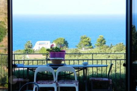 3 bedroom houses for sale in Sicily. Villa with a garden and a picturesque sea view in Cala Bianca bay, in Scopello, Sicily, Italy