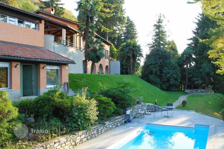 Luxury 5 bedroom houses for sale in Central Europe. Villa with private vineyard, guest house, pool and spa in Pugerne, Lugano