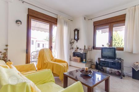 Residential for sale in Chalkidiki. Bright and spacious apartment with a large veranda, garden around the house, 200 meters from the sea, the peninsula of Kassandra, Halkidiki