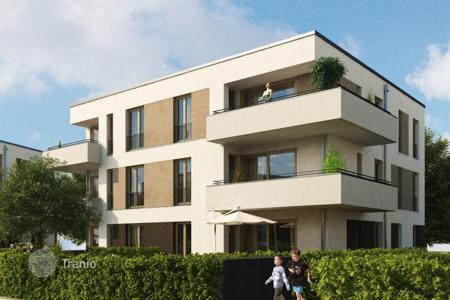 3 bedroom apartments for sale in North Rhine-Westphalia. The modern two-level apartment with a balcony, terrace and garden in a new building, district Vittlaer, Düsseldorf