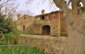 Luxury houses for sale in San Quirico D'orcia. Ancient two-storey villa with a church in San Quirico d'Orcia, Tuscany, Italy