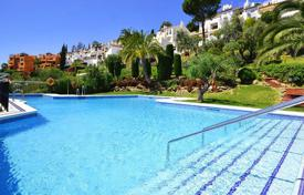 Cheap apartments for sale in Benahavis. Apartment with terrace with sea and mountain view, in a residence with swimming pool and garden, in Benahvavís, Malaga, Spain