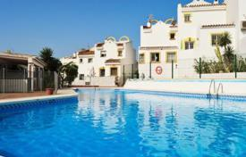 Townhouses for sale in Costa del Sol. Corner townhouse with a terrace in a residential complex with a swimming pool and a shopping center, Marbella, Spain