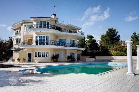 Luxury houses with pools for sale in Greece. Beautiful three-storey villa in the first line in Attica