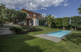 Luxury 4 bedroom houses for sale in Catalonia. Exclusive three-storey villa with a pool, a garden and a sea view, in a closed residence, next to the golf course, Teia, Spain