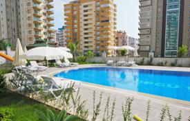 Cheap apartments with pools for sale overseas. New apartment with sea view, in a luxury complex with a garden and a swimming pool. The center of Mahmutlar, Alanya, 400 m from the beach