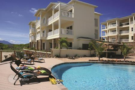 Apartments with pools for sale in Saint George Basseterre Parish. Nice apartment near the beach in the bay coral Frigate Bay