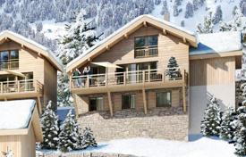 Houses with pools for sale in Auvergne-Rhône-Alpes. New three-storey chalet with a balcony and a garage, in a popular resort village, next to the ski lift, Isère, Alpes, France
