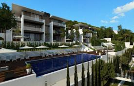 New homes for sale in Catalonia. Modern apartment with a garden, in a new residential complex with a pool, Castell Platja d'Aro, Spain