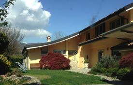 Modern villa with a terrace, lake views, a pool and a spacious plot, Meina, Piedmont, Italy. Price on request