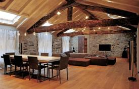 The design attic apartment in in style of a chalet in the city centr of Como for 1,950,000 €