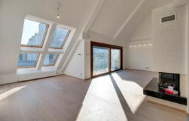 Residential for sale in Hungary. New two-level penthouse with a large terrace and a fireplace, in a renovated historical 19th century building, the 6th district, Budapest