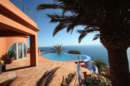 Luxury 6 bedroom houses for sale in Alicante. Modern villa with a panoramic swimming pool, on the sea front in Javea