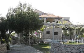 6 bedroom houses for sale in Croatia. Furnished villa with a private garden, a garage, terraces and a sea view, Primosten, Croatia