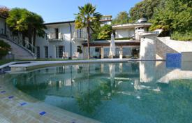 Luxury houses for sale in Stresa. Luxury villa with a terrace, a pool and lake views, Stresa, Piedmont, Italy