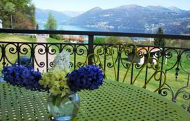 Luxury houses for sale in Southern Europe. Villa with garden and the lake view, a few minutes from Lake Maggiore and the city of Luino surrounded by greenery, in Brezzo di Bedero