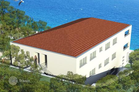 New homes for sale in Croatia. New apartments with different layouts, terraces, balconies, in a residence in a quiet district, on the first line to the sea, Trogir, Croatia