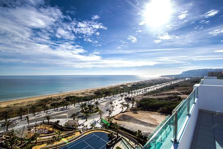 Apartments with pools for sale in Arenals del Sol. Penthouse with large solarium and sea views in Arenales del Sol
