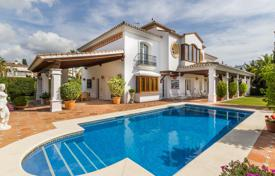 Houses with pools by the sea for sale in Marbella. Three-storey sea view villa with terraces, in a prestigious district, 300 m from the beach, Marbella, Spain. Great investment opportunity!