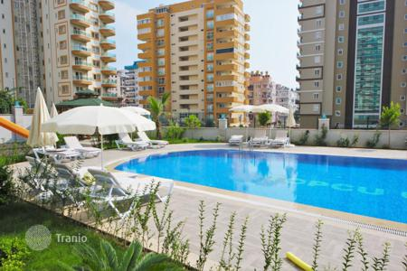 Cheap apartments with pools for sale in Western Asia. New apartment with sea view, in a luxury complex with a garden and a swimming pool. The center of Mahmutlar, Alanya, 400 m from the beach
