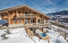 Luxury houses with pools for sale in Auvergne-Rhône-Alpes. Comfortable chalet with a pool and views of the Mont Blanc and the Megeve mountains, Alps, France