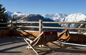 5 bedroom villas and houses to rent in Valais. The chalet with 5 bedrooms, a living room with a balcony, a ski room with a boot dryer and a hot tub, Verbier, Switzerland
