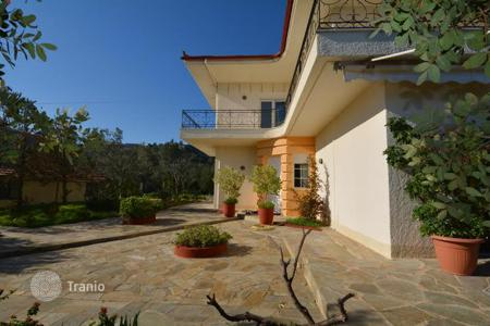 Property for sale in Administration of the Peloponnese, Western Greece and the Ionian Islands. Furnished villa with a fireplace, a garden and a panoramic sea view, in a guarded residential complex, near the beach, Epidaurus, Greece