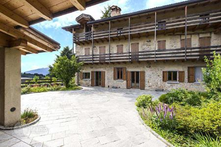 Luxury houses with pools for sale in Caprino Bergamasco. Medieval villa near Lake Como in Italy