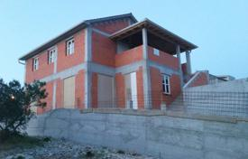 Houses with pools by the sea for sale in Sibenik-Knin. Villa under construction