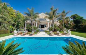Houses for sale in Puerto Banús. Exquisite mansion in a classical style on the beach in Puerto Banus, Costa del Sol, Spain