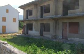 Development land for sale in Dubrovnik Neretva County. Plot of land with a two-level house in the town of Cavtat, Croatia