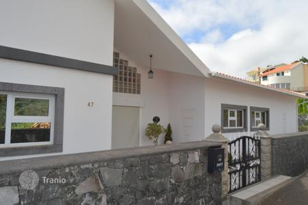 Townhouses for sale in Portugal. Spectacular one level house for sale Calheta