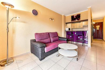 Cheap residential for sale in Adeje. Oceanview apartment with a terrace in a residential estate with a pool, Playa-de-las-Americas, Tenerife, Spain