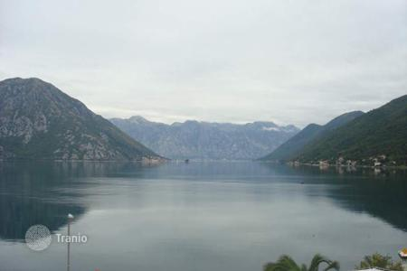 Coastal land for sale in Kotor. Flat plot of land of 778 m² in a picturesque fishing village Morinj, excellent for the construction and further living