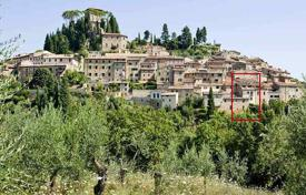 Townhouses for sale in Italy. Old four-storey townhouse in the center of Cetona, Tuscany, Italy