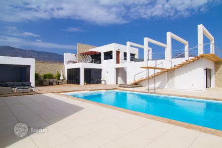 4 bedroom houses for sale in Canary Islands. Amazing modern villa with pool in a prestigious area of Tenerife