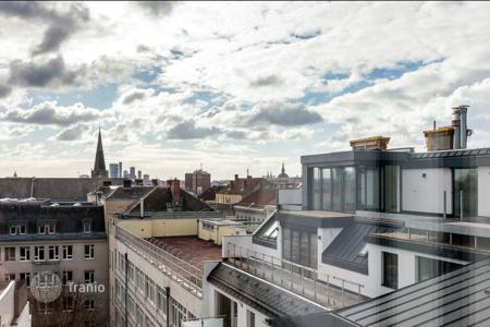 Apartments for sale in Neubau. Loft with a large terrace and panoramic windows, in a historic building, Vienna, Austria