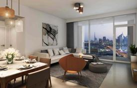 Apartments from developers for sale in Western Asia. Cozy two-room flat with a balcony in a residential complex with a pool, Dubai, UAE