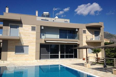 Houses with pools for sale in Attica. Modern villa in the first line in Attica